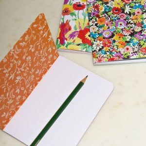 A6 Floral mix exercise books open