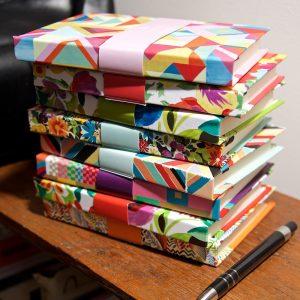 Pile of A6 address books