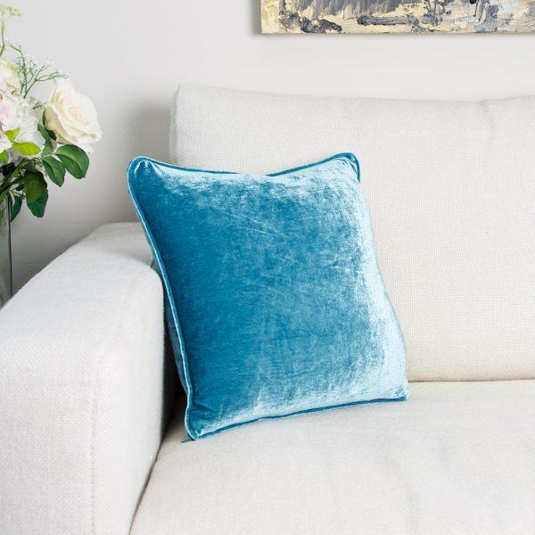 Turquoise velvet cushion